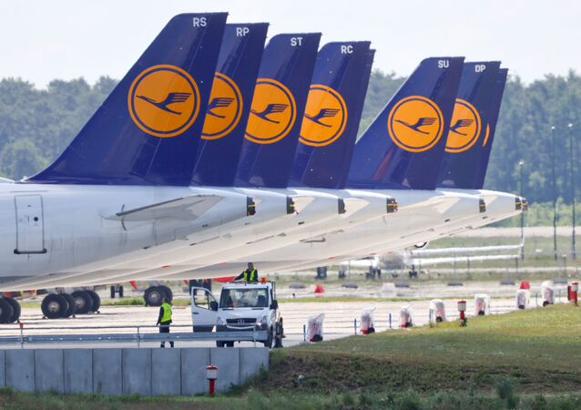 FILE PHOTO: Airplanes of German carrier Lufthansa are parked at the Berlin Schoenefeld airport, amid the spread of the coronavirus disease (COVID-19) in Schoenefeld, Germany, May 26, 2020