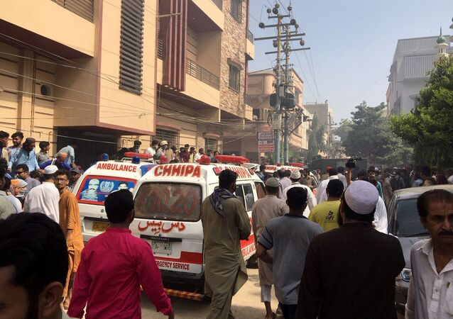 Ambulances and fire vehicles gather at the site of a passenger plane crash in a residential area near an airport in Karachi, Pakistan 22 May 2020