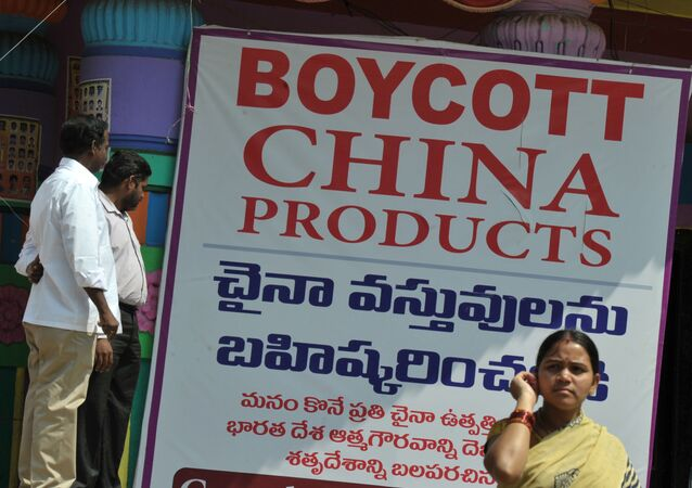 Members of the Ganesh Utsav Committee stand alongside a poster declaring 'Boycott China Products' in Hyderabad on November 3, 2016.