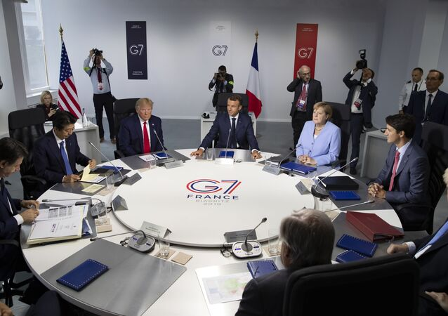 From the left, Italian Prime Minister, Giuseppe Conte, Japanese Prime Minister Shinzo Abe, U.S President Donald Trump, French President Emmanuel Macron, German Chancellor Angela Merkel, Canadian Prime Minister Justin Trudeau, Britain's Prime Minister Boris Johnson attend a work session during the G7 summit at Casino in Biarritz, southwestern France, Monday Aug.26 2019