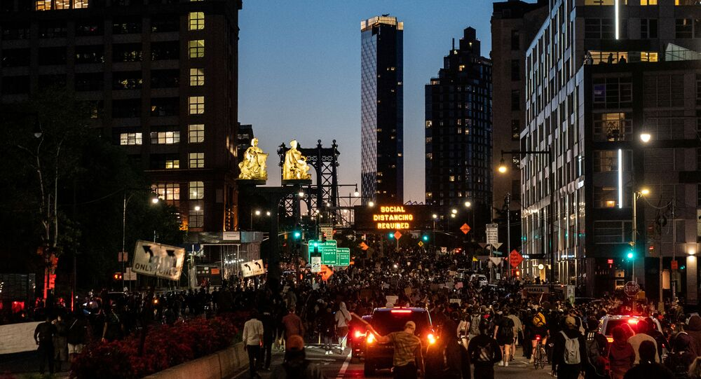 Protesters rally against the death in Minneapolis police custody of George Floyd, near Manhattan bridge in the Brooklyn borough of New York City, U.S., May 31, 2020. Picture taken May 31, 2020