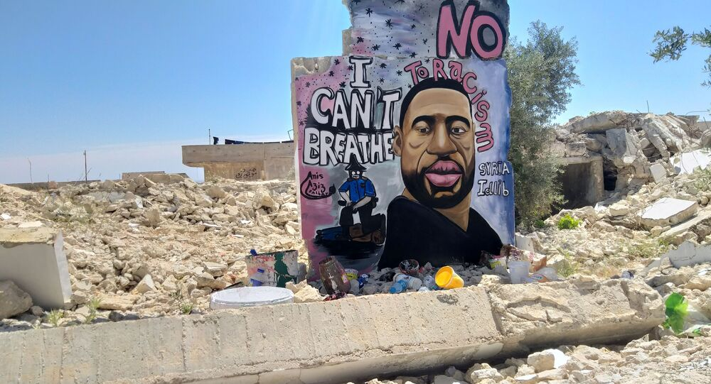 A graffiti of George Floyd is pictured in Idlib