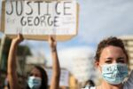 People wear protective face masks during a protest against the death in Minneapolis police custody of George Floyd, in front of a U.S. consulate, in Barcelona, Spain June 1, 2020
