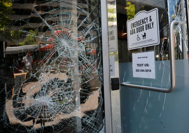 Damaged windows are seen at a restaurant near the White House which was vandalized during overnight protests and rioting amidst nationwide unrest following the death in Minneapolis police custody of George Floyd, in Washington, U.S., May 31, 2020