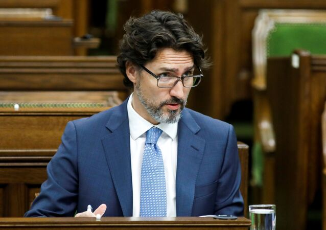 Canada's Prime Minister Justin Trudeau waits for a meeting of the special committee on the COVID-19 pandemic to begin, as efforts continue to help slow the spread of the coronavirus disease (COVID-19), in the House of Commons on Parliament Hill in Ottawa, Ontario, Canada May 13, 2020.