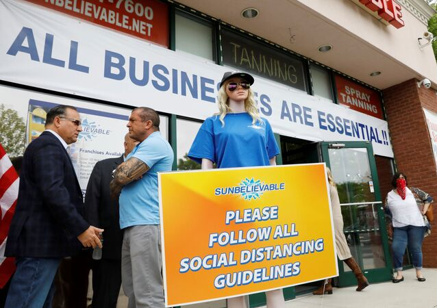 Bobby Catone, owner of Sunbelievable, prepares to open his business against local health recommendations as the outbreak of the coronavirus disease (COVID-19) continues in the Staten Island borough of New York, U.S., May 28, 2020.