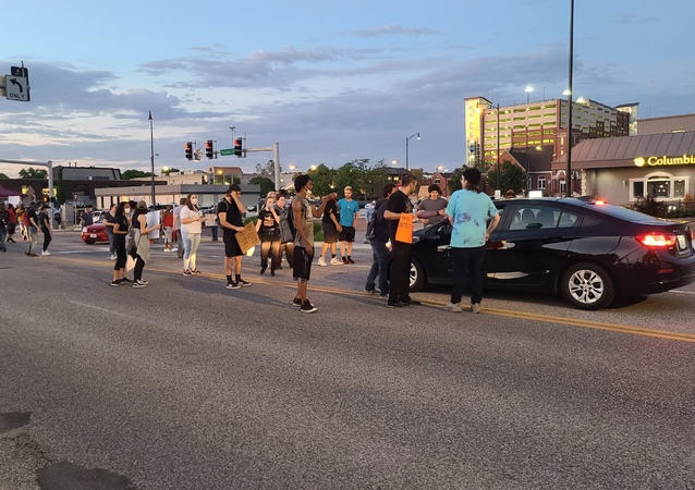 Protesters blocking an intersection in Columbia, Missouri, after the death of African American George Floyd, following his arrest in Minneapolis.