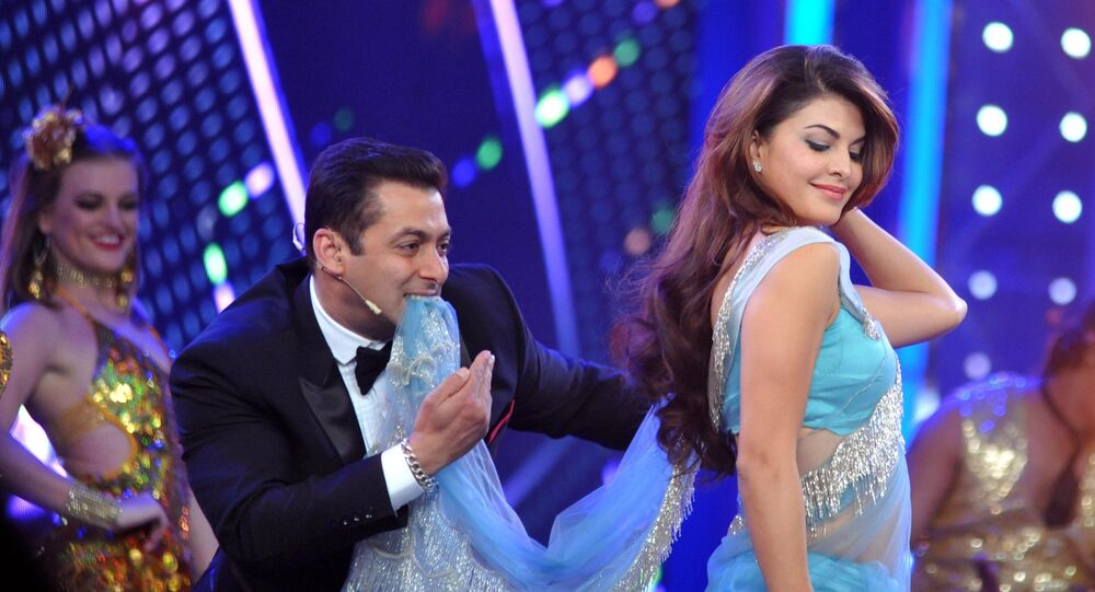Indian Bollywood actors Salman Khan (C) and Jacqueline Fernandez on the set of television show Bigg Boss 8 in Lonavala on January 3, 2015. AFP PHOTO/STR