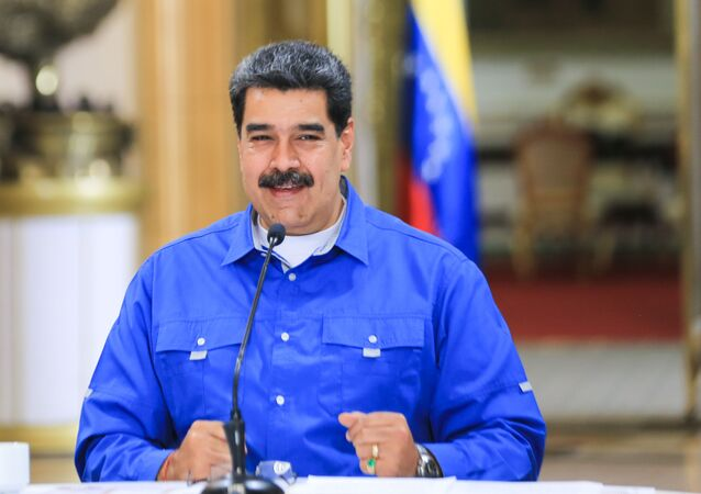 Handout picture released by Venezuelan Presidency showing Venezuelan President Nicolas Maduro speaking during a video conference meeting with members of his cabinet, at Miraflores Presidential Palace in Caracas, on June 1, 2020