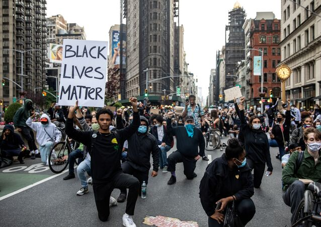 Protesters have a moment of silence during a rally against the death in Minneapolis police custody of George Floyd, in the Manhattan borough of New York City, U.S., June 1, 2020