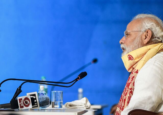 In this handout photograph taken on May 22, 2020 and released by the Indian Press Information Bureau (PIB), India's Prime Minister Narendra Modi speaks during a review meeting with officials after his aerial survey of affected areas in the state from cyclone Amphan, in Basirhat, West Bengal.