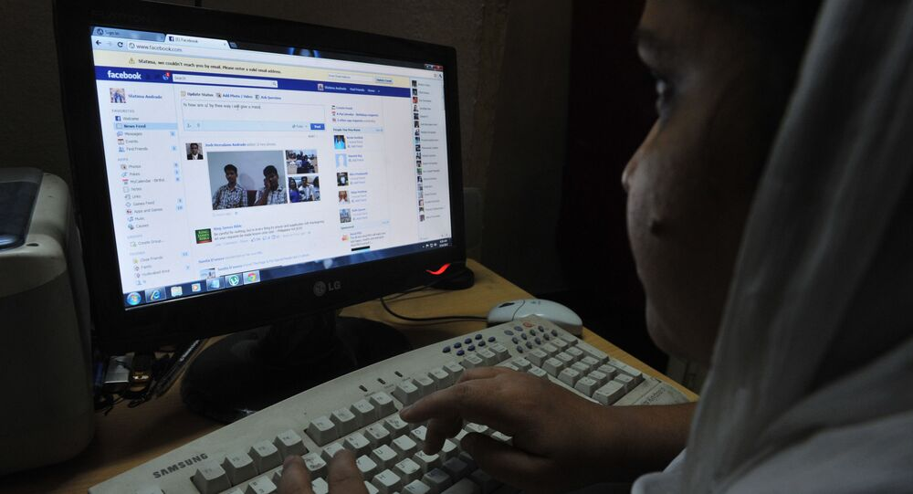 An Indian woman logs onto Facebook on her computer at her home in Hyderabad on May 14, 2012