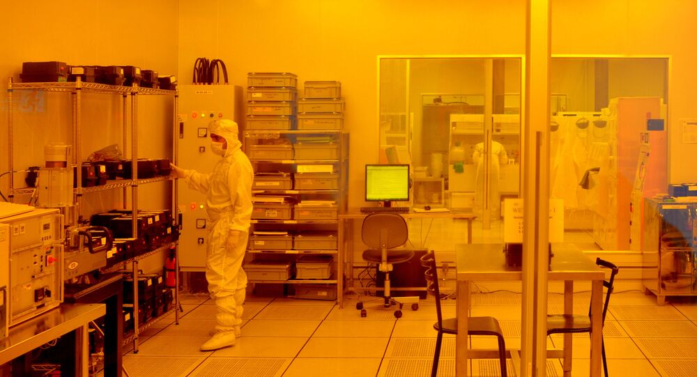 Researchers wearing bunny suits work inside the semiconductor fabrication lab at the Centre for Nano Science and Engineering (CENSe), situated at the Indian Institute of Science (IISc), in Bangalore on June 30, 2018