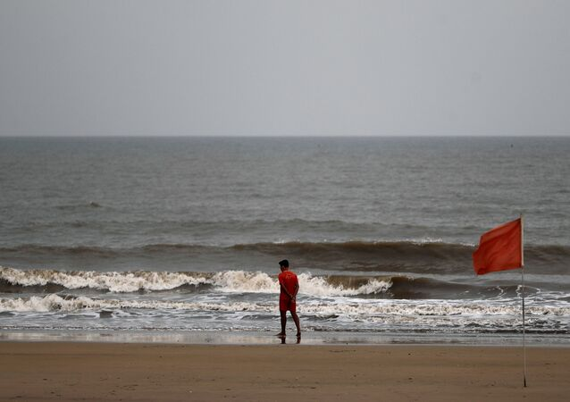 A lifeguard walks along the shore off the Arabian Sea before cyclone Nisarga makes its landfall, in Mumbai, India, June 2, 2020. REUTERS/Francis Mascarenhas