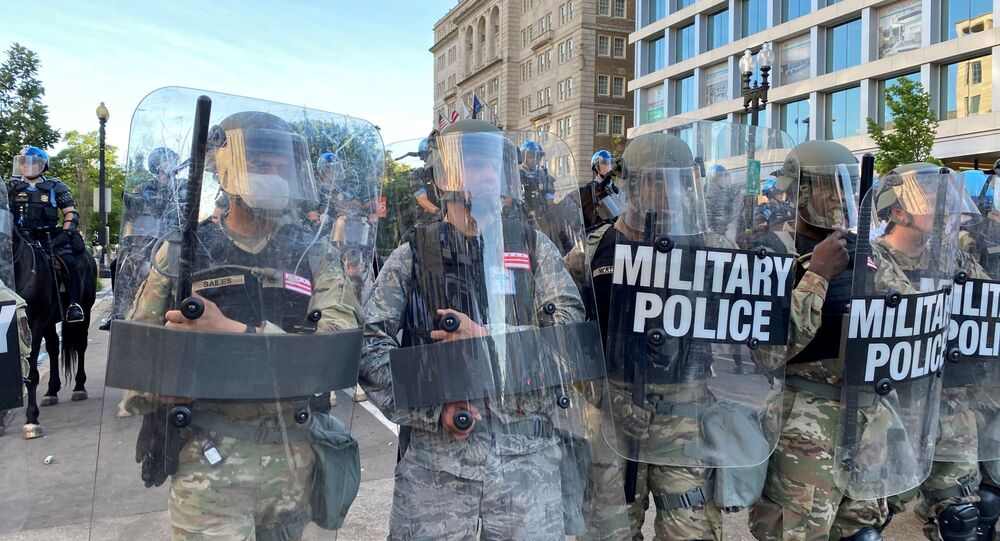 Washington, D.C. National Guard military police block a street near the White House from protestors as the number of U.S. military forces deployed to the streets of the nation's capital increases, while protests continue against the death in Minneapolis police custody of George Floyd, in Washington, U.S., June 1, 2020.
