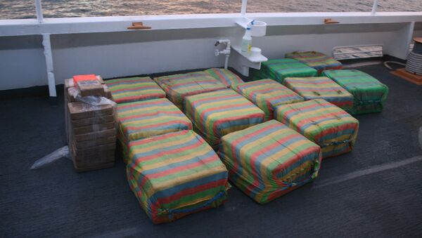 Suspected cocaine is shown on the deck of the Coast Guard Cutter Confidence in international waters of the Pacific Ocean off Central America in mid-May 2020. The Coast Guard seized approximately 1,090 pounds of suspected cocaine in mid-May with an estimated value of $18.7 million from a go-fast vessel - Sputnik International
