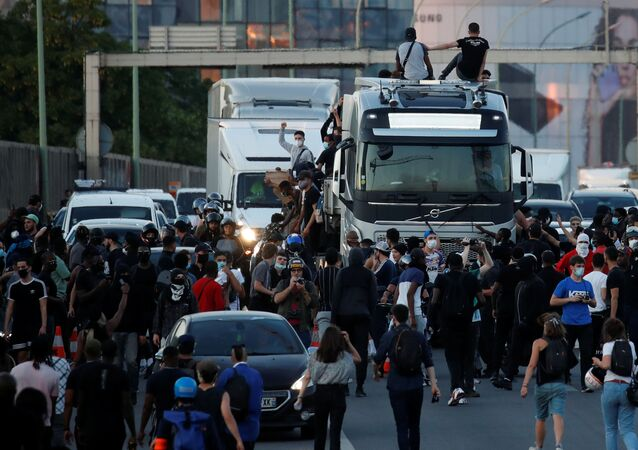 People block the road as they attend a banned demonstration planned in memory of Adama Traore, a 24-year old black Frenchman who died in a 2016 police operation which some have likened to the death of George Floyd in the United States, near the courthouse in Paris, France June 2, 2020