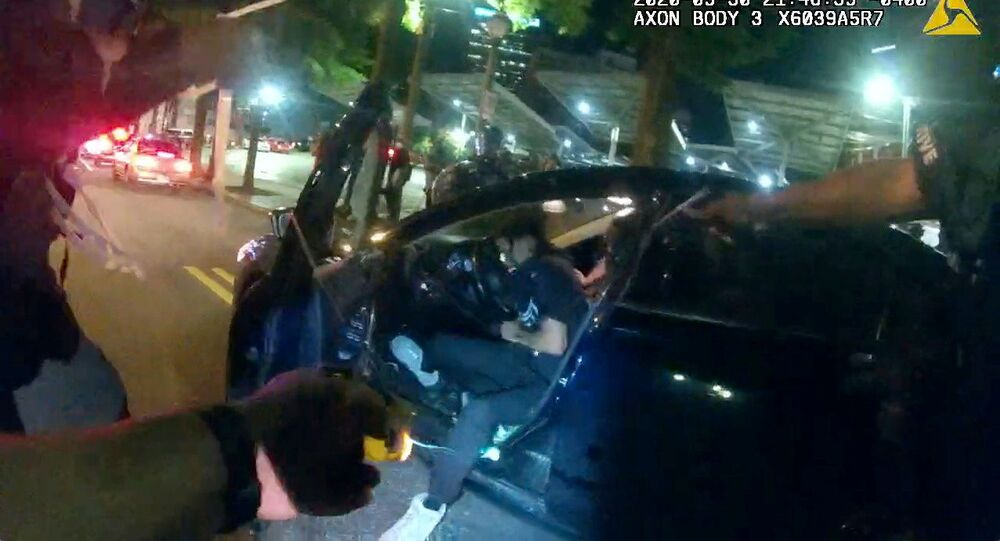 Still frame from Atlanta Police Department bodycam video footage of police officer Ivory Streeter, shows car driver Messiah Young being shot by a taser, during ongoing protests against the death in Minneapolis police custody of George Floyd, in Atlanta, Georgia, U.S. May 30, 2020