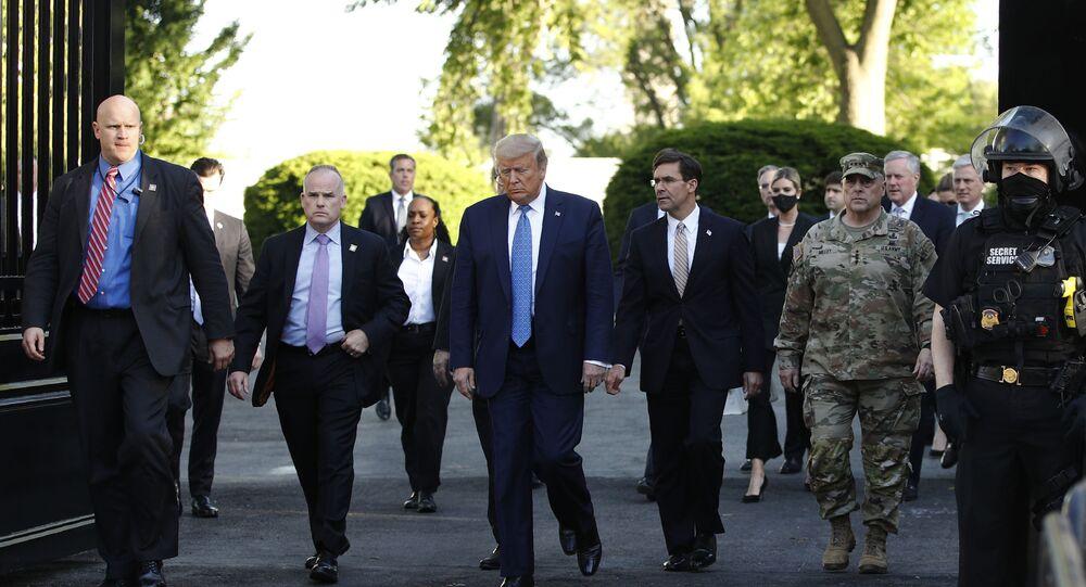 President Donald Trump walks from the White House to visit St. John's Church across Lafayette Park Monday, June 1, 2020, in Washington.