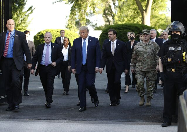 President Donald Trump walks from the White House to visit St. John's Church across Lafayette Park Monday, June 1, 2020, in Washington.