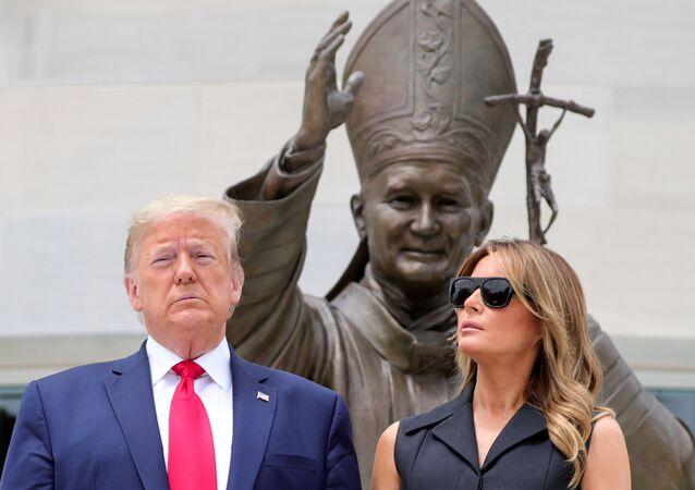 U.S. President Donald Trump and first lady Melania Trump pose during a visit to the Saint John Paul II National Shrine in Washington, U.S., June 2, 2020