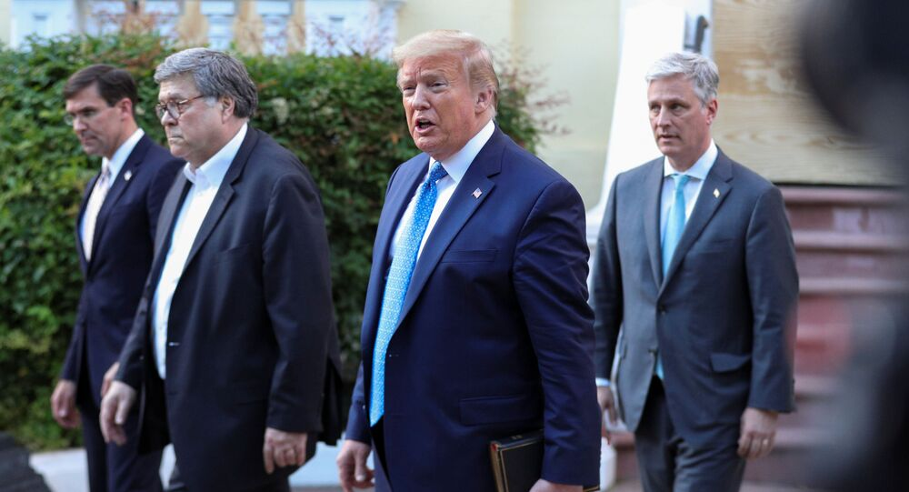 U.S. President Donald Trump walks with U.S. Defense Secretary Mark Esper, U.S. Attorney General Bill Barr and National Security Advisor Robert O'Brien during a photo opportunity in front of St. John's Episcopal Church across from the White House amidst ongoing protests over racial inequality in the wake of the death of George Floyd while in Minneapolis police custody, near the White House in Washington, U.S., June 1, 2020