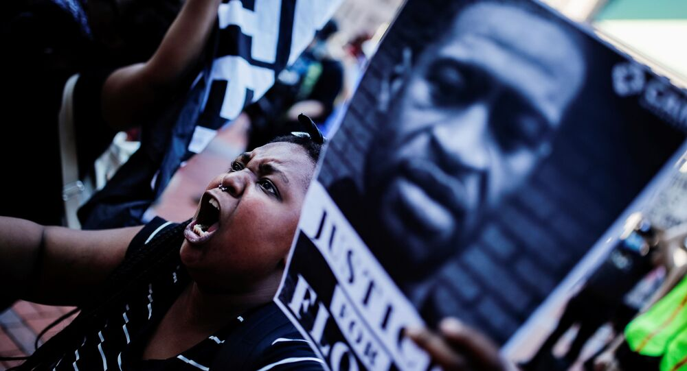 A protester reacts while gathering with others outside the city hall after a white police officer was caught on a bystander's video pressing his knee into the neck of African-American man George Floyd, who later died at a hospital, in Minneapolis, Minnesota, U.S., May 28, 2020.
