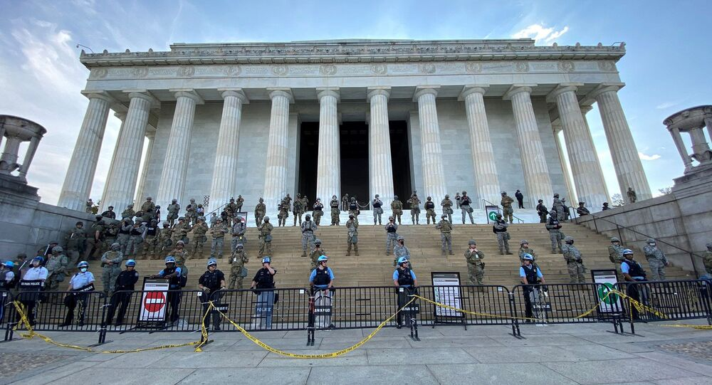 Law enforcement personnel stand guard on the steps of the Lincoln Memorial as protests spread across U.S. cities in reaction to the death in Minneapolis police custody of George Floyd, in Washington, D.C., U.S. June 2, 2020, in image obtained from social media