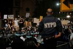 NYPD officers face demonstrators after curfew during a protest against the death in Minneapolis police custody of George Floyd, in New York City, U.S., June 2, 2020.