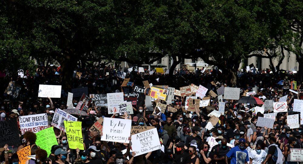 Protesters rally against the death in Minneapolis police custody of George Floyd, in Houston, Texas, U.S. June 2, 2020.