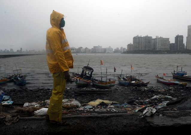 A Mumbai police official stands guard off the coast of the Arabian sea in Mumbai as cyclone Nisarga makes its landfall, on the outskirts of Mumbai, India, June 3, 2020.