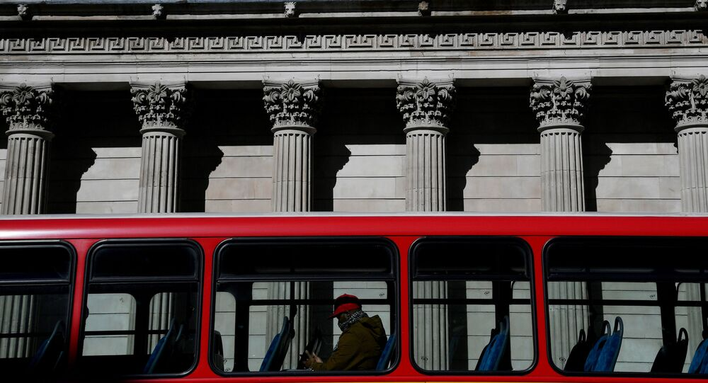 A quiet bus passes the Bank of England, as the spread of the coronavirus disease (COVID-19) continues, in London, Britain, March 23, 2020