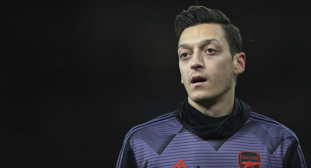 Arsenal's Mesut Ozil warms up prior the English Premier League soccer match between Arsenal and Manchester City, at the Emirates Stadium in London, Sunday, Dec. 15, 2019