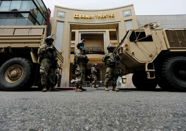 National Guard's members are seen in front of the Dolby Theatre along Hollywood Boulevard during a rally against George Floyd death in Minneapolis police custody, in Los Angeles, California, U.S., June 2, 2020