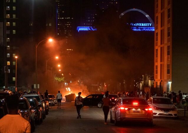 A fire set in the middle of a street is pictured during a protest against the death in Minneapolis police custody of African-American man George Floyd, in St Louis, Missouri, U.S. June 1, 2020. Picture taken June 1, 2020