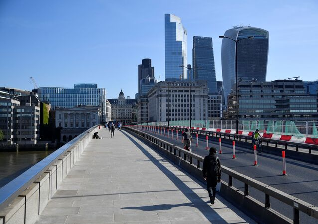 People cross London Bridge
