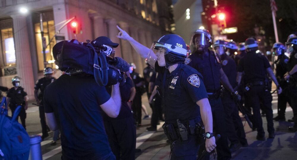 A police officer shouts at Associated Press videojournalist Robert Bumsted, Tuesday, June 2, 2020, in New York