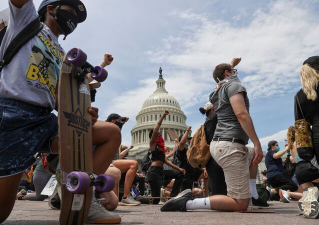 People take a knee during a Black Lives Matter rally, as protests continue over the death in Minneapolis police custody of George Floyd, outside the U.S. Capitol in Washington, U.S., June 3, 2020