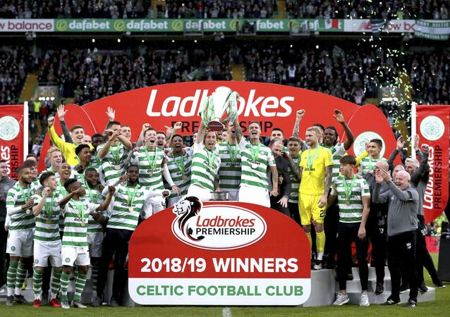 Celtic players celebrate with the trophy after winning the Scottish Premiership League soccer match at Celtic Park, Glasgow, Scotland, Sunday May 19, 2019