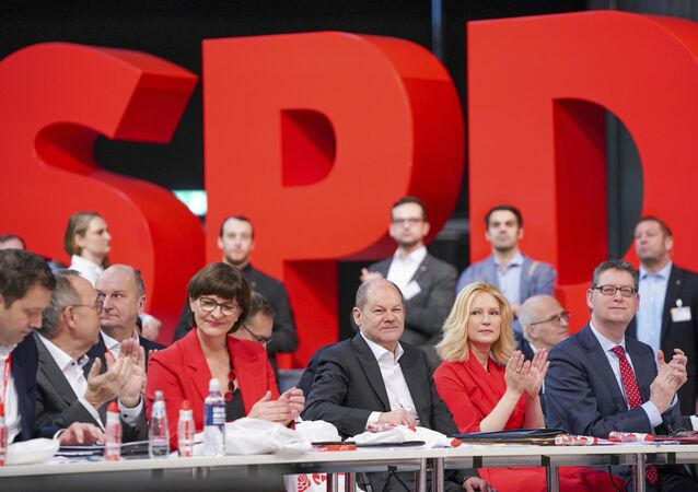 Party secretary Lars Klingbeil, Norbert Walter-Borjans, Saskia Esken, Federal Finance Minister Olaf Scholz, Manuela Schwesig and Thorsten Schaefer-Guembel, from left, during the  German Social Democrats, SPD, federal party conference in Berlin, Germany, Friday, Dec. 6, 2019.