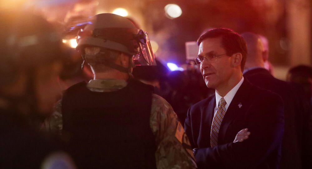 U.S. Defense Secretary Mark Esper talks to a member of DC National Guard, in Washington, D.C., U.S., June 1, 2020