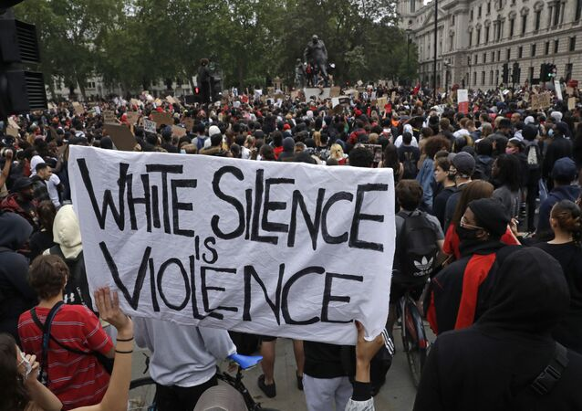 Protesters gather during a demonstration in Parliament Square in London on Wednesday, June 3, 2020, over the death of George Floyd, a black man who died after being restrained by Minneapolis police officers on May 25. Protests have taken place across America and internationally, after a white Minneapolis police officer pressed his knee against Floyd's neck while the handcuffed black man called out that he couldn't breathe. The officer, Derek Chauvin, has been fired and charged with murder. (AP Photo/Matt Dunham)