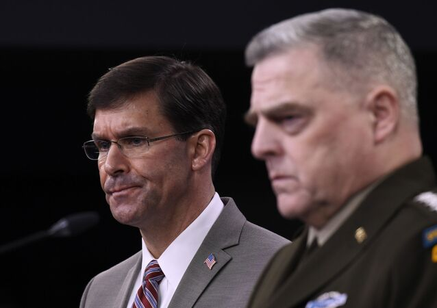 Defense Secretary Mark Esper, left, and Chairman of the Joint Chiefs of Staff Army Gen. Mark Milley, right, during a briefing at the Pentagon in Washington, Monday, March 2, 2020. (