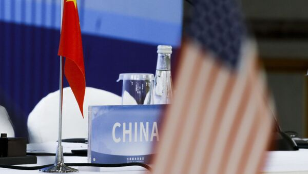 The Chinese and U.S. national flags are seen before the start of a Treaty on the Non-Proliferation of Nuclear Weapons (NPT) conference in Beijing of the UN Security Council's five permanent members (P5) China, France, Russia, the United Kingdom, and the United States, China, Wednesday, Jan. 30, 2019.  - Sputnik International