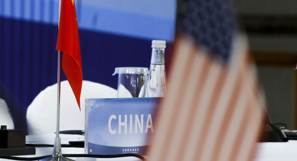 The Chinese and U.S. national flags are seen before the start of a Treaty on the Non-Proliferation of Nuclear Weapons (NPT) conference in Beijing of the UN Security Council's five permanent members (P5) China, France, Russia, the United Kingdom, and the United States, China, Wednesday, Jan. 30, 2019.