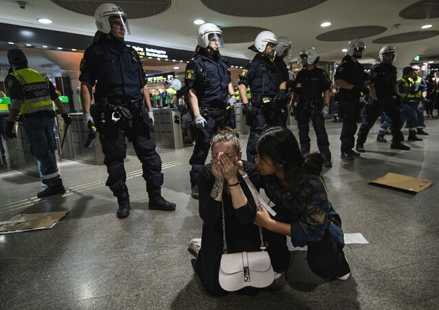 A protester reacts after being pepper sprayed by police in a subway station during a Black Lives Matter demonstration in Stockholm, Sweden, on June 3, 2020, in solidarity with protests raging across the United States over the death of George Floyd