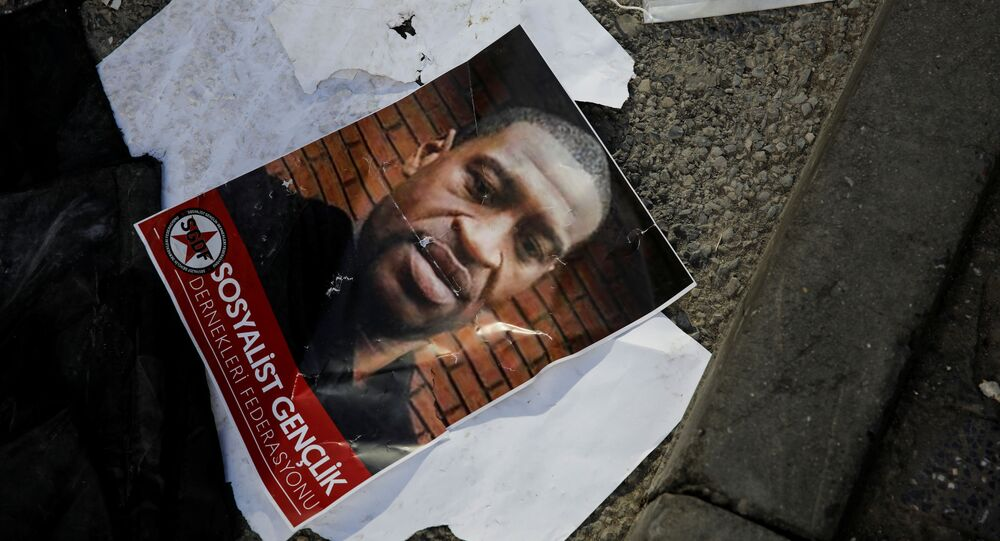 A portrait of George Floyd, who died in police custody in  Minneapolis, U.S., lies on the ground next to a protective face mask after a scuffle took place during a protest in Istanbul, Turkey, June 2, 2020