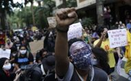 People protest against crimes committed by the police against black people in the favelas, outside Rio de Janeiro's state government, Brazil, Sunday, 31 May 2020