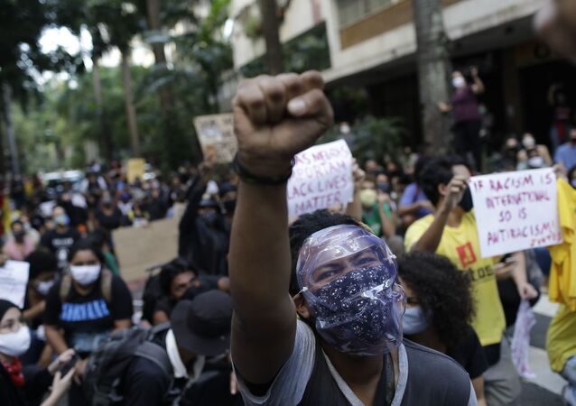 People protest against crimes committed by the police against black people in the favelas, outside the Rio de Janeiro's state government, Brazil, Sunday, May 31, 2020