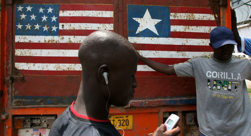 The American and Liberian flags on display on a truck in the Liberian capital Monrovia, which was named after a US president.